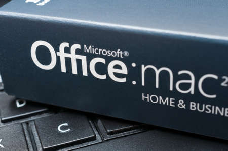 microsoft: Box With Microsoft Office for Mac Software Placed on Notebook - Shallow Depth of Field Editorial