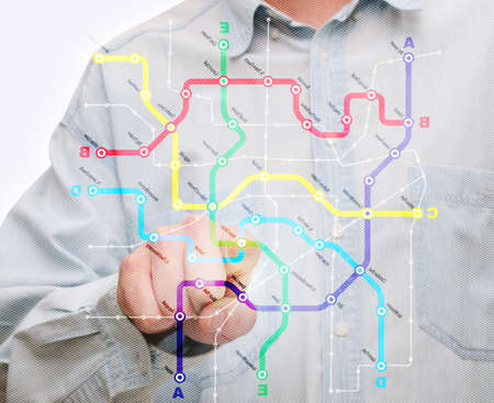cocaine: Man Touching City Transport Map on Touch Screen Stock Photo