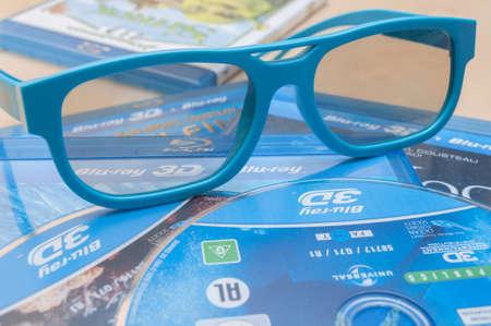 bluray: PRAGUE, CZECH REPUBLIC – JANUARY 1, 2014: 3D Technology - Photo of a Plastic 3D Glasses and 3D Blu-Ray Discs