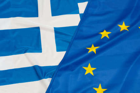 crisis: Close up of flags of European Union and Greece
