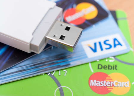 mastercard: PRAGUE, CZECH REPUBLIC - AUGUST 7, 2015: Photo of VISA and MasterCard and Mobile Broadband USB Stick