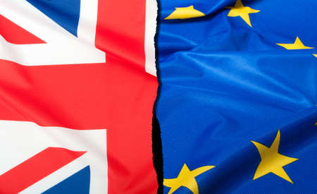 Brexit - Detail of Separated Silky Flags of European Union and United Kingdom Standard-Bild