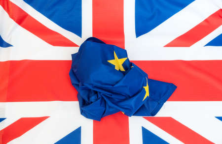 scrunched: Creased Flag of European Union on the Flag of the United Kingdom Stock Photo