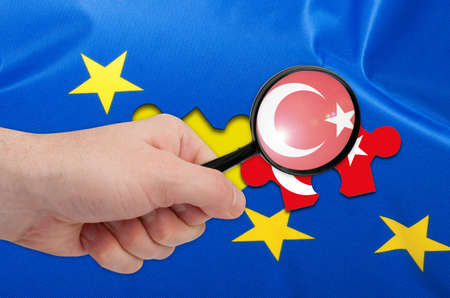 skepticism: Turkey Accession - Detail of Silky Flag of Blue European Union EU Flag Drapery With Turkish Puzzle Piece