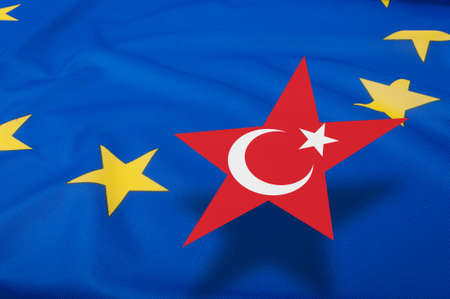 overtake: Turkey Accession - Closeup of Glossy Flag of European Union With Turkish Star  - Shallow Depth of Field