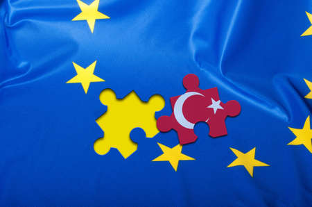 Detail of Silky Flag of Blue European Union EU Flag Drapery With Puzzle Piece With Turkey
