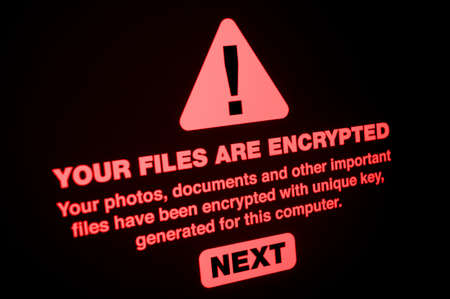 Ransomware - Close up of Your Files Are Encrypted on the Screen Foto de archivo