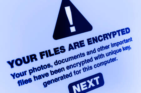 cybercrime: Ransomware - Close up of Your Files Are Encrypted on the Screen Stock Photo