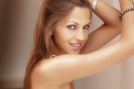 Beautiful woman smiling into camera photo