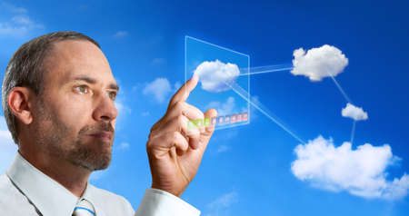 Businessman works with Virtual Cloud Computer Stock Photo - 9170719