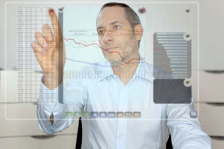Businessman works with futureistic computer display photo