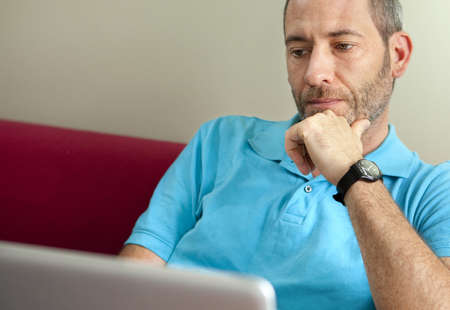 matrue man with laptop at home Stock Photo