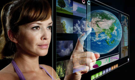 woman working with futuristic screen Stock Photo