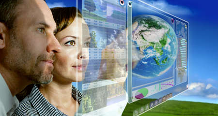futuristic woman: man and woman are working with futuristic screen Stock Photo