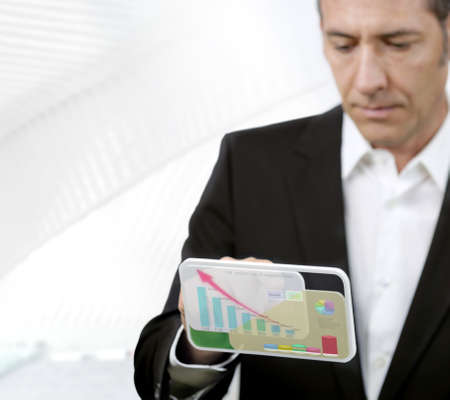 Businessman works with futuristic PDA photo