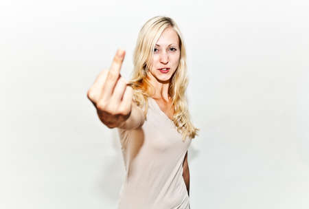 tough: girl showing the finger, while saying fuck you! Stock Photo