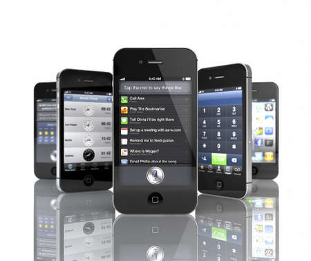 Aachen, Germany - November 14, 2011: Studio shot of 5 Apple iPhone 4S showing the Siri Speech and social media App