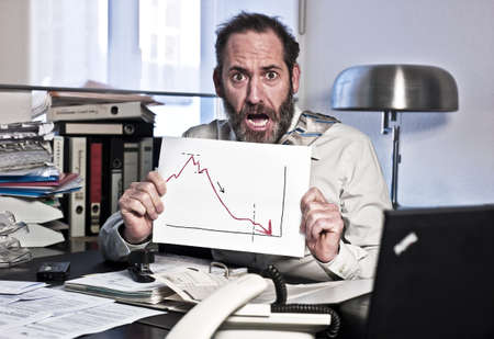 Businessman sees the bankrupcy and gets panic {shot on PhaseOne P45} Stock Photo - 11590538
