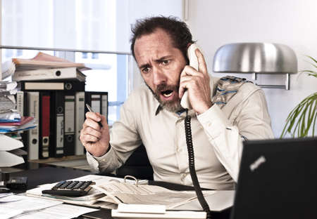 angry person: Businessman goes upset while on the phone {shot on PhaseOne P45}