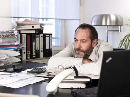 Contemplative businessman looking away at work. Horizontal shot Stock Photo - 11785012
