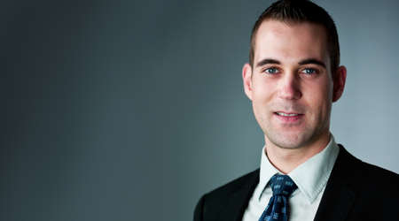 likable: likable young Businessman looks into camera