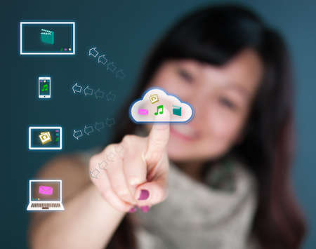 Cute Young woman working with multimedia cloud photo