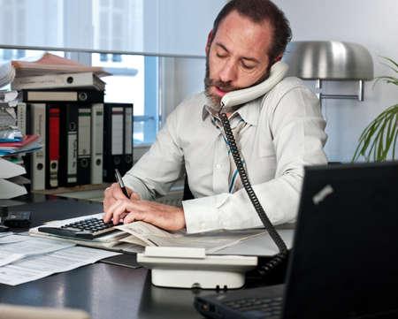 45: Mature businessman on the phone  Horizontal shot