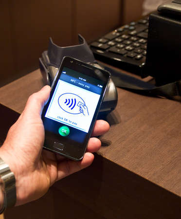 The new way to pay  NFC payments via mobile phone, etc Stock Photo - 13491998