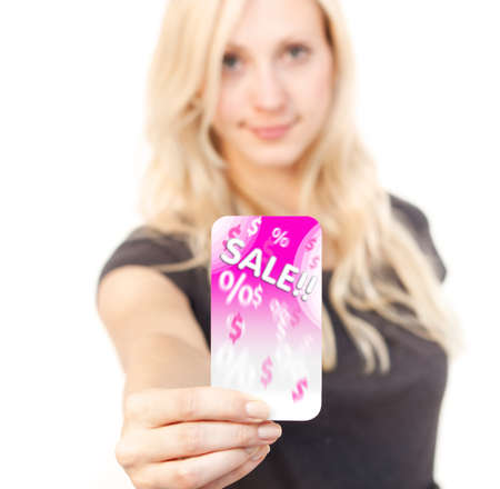discount card: Young woman is smiling while showing discount Card Stock Photo