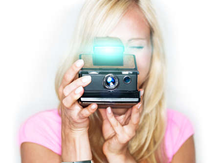 photographic camera: beautiful woman holds vintage photo camera Stock Photo
