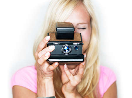beautiful woman holds vintage photo camera photo