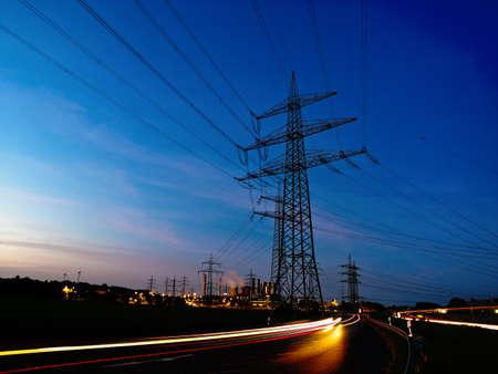 electricity pylon: power plant by night
