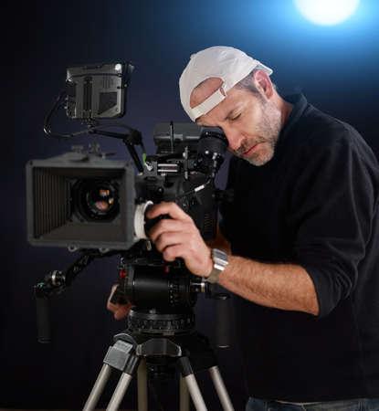filmmaker: cameraman working with a cinema camera