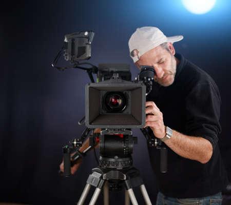 camarógrafo de trabajo con una cámara de cine Foto de archivo