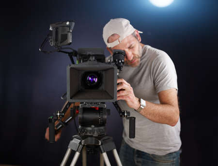 video camera: cameraman working with a cinema camera