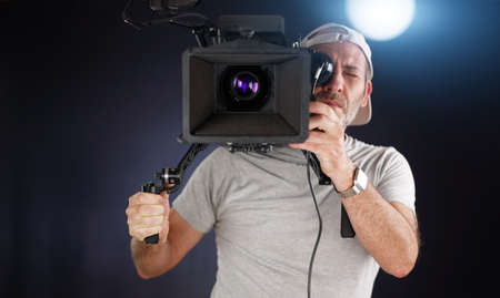 cameraman working with a cinema camera photo