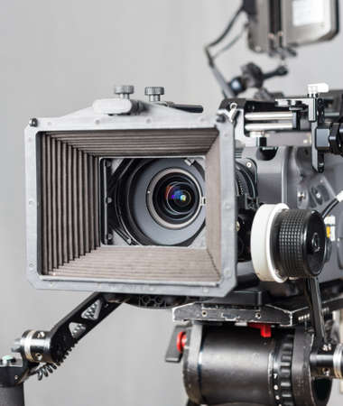 close up of an expensive cinema camera with accesories