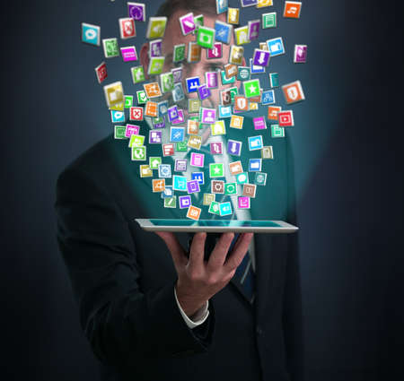 telephone salesman: tablet pc with cloud of application icons Stock Photo