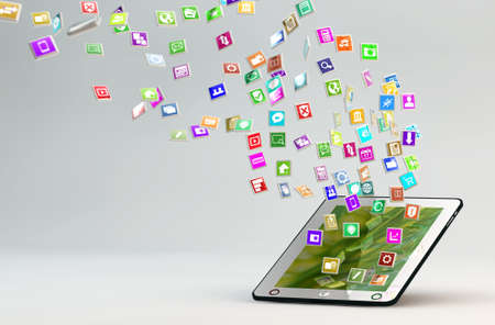 tablet pc with lots of apps flying around Stock Photo