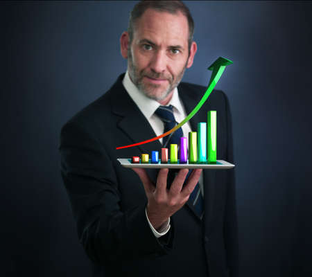Businessman with Tablet Pc shows an analysis tool graph photo