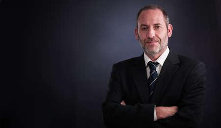 successful senior executive businessman smiling into the camera Stok Fotoğraf - 20904862