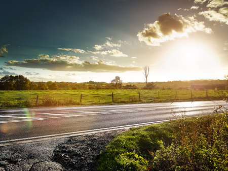 country road at sundown, cloudy backlite shot  peferct for car copy space photo