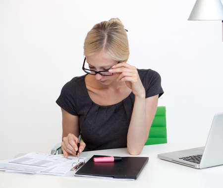 Young Business woman is smiling while working at work desk photo