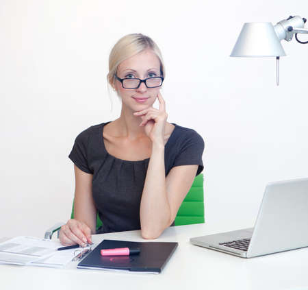 Young Business woman is smiling while working at work desk Stock Photo - 26712119