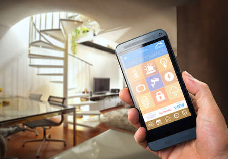 smarthouse home automation device with app icons. Man uses his smartphone with smart home security app to unlock the door of his house. photo