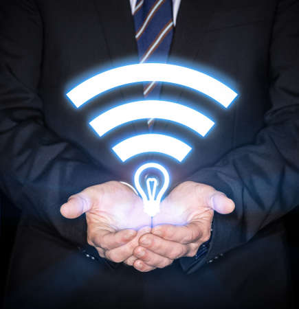 computer networking: Li-Fi W-Lan technology, internet and networking concept - Young businessman activates Li-Fi High speed connection