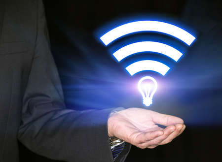 data transmission: Li-Fi W-Lan technology, internet and networking concept - Young businessman activates Li-Fi High speed connection
