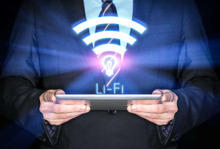 telecom: Li-Fi W-Lan technology, internet and networking concept - Young businessman activates Li-Fi High speed connection
