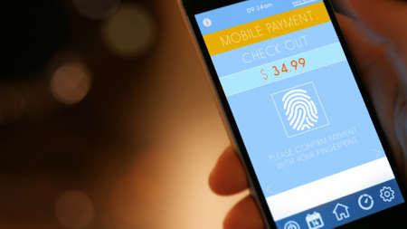 contactless: Mobile Payment,  smart pay - man holding a phone with contactless pay wallet app for smart shopping