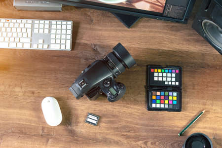 analogous: Top view of a modern desktop shot Digital Medium Format Camera with laptop on stylish Photo wooden desktop Workplace Background